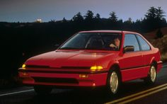 "1986 Acura Integra - first generation. My first car was a 87, but it looked just like this. It was a pretty sweet first car. CD player, sunroof, and I had red Hawaiian print seat covers and steering wheel cover. I called it ""Bing""."
