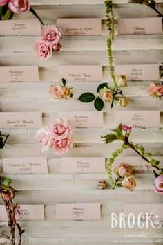 Pink spray roses, green amaranthus and ivory flowers decorated the shutters for guest cards. www.carolineplusben.com