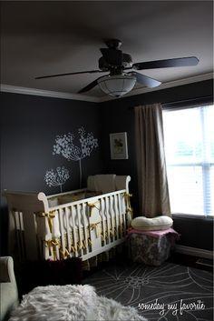 nursery with dark gray walls, linen drapes