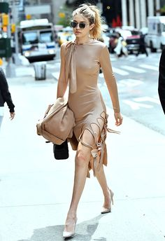 It wouldn't be a Gigi Hadid round-up without her signature colour palette. Proving she got the Yeezy memo, GH stepped out in this jersey dress with leg slits (v Season 1), plus a matching bag. Fashion powers, tick