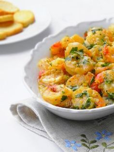 Crevettes au four, huile dolive, ail et persil