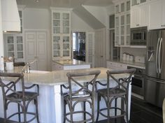 Amazing kitchen design with white glass-front kitchen cabinets...equal organized.