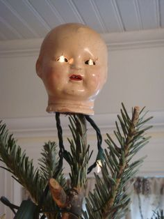 the scariest Christmas tree topper ever...