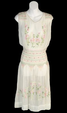 Vintage 1920's Hand Embroidered and smocked cotton voile dress    This estate had such beautiful vintage dresses! This one is one of the dresses the owner bought for her honeymoon in 1929. We love the pretty embroidery and the pastel shades! Perfect bridesmaid dress for the 1920's wedding!