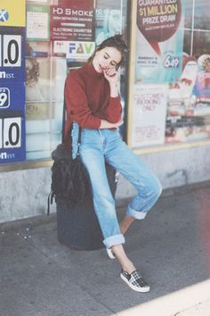 Urban fashion | Red turtle neck sweater tucked in high-waist jeans