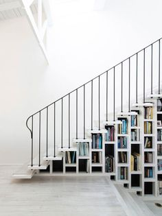 Imagine all the stories under the stairs. | 24 Times Bookshelf Porn Was Just So Fucking Hot