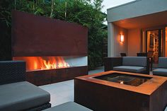 Garden Design article on fire feature considerations for your outdoor living space. (Modern outdoor seating with fireplace pictured.)