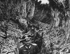 Hitler visiting one of the trenches he had served in during the First World War. Fromelles, France – 1940.