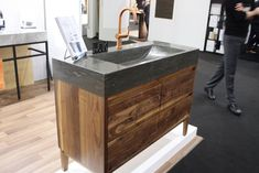 A wide, gently curved sink carved into the countertop is perfect for those who refer not to have a vessel style basin.