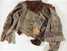 Agnes Richter, held in an asylum for the insane in the 1890's, embroidered text on her jacket, which was part of the uniform given to patients at the time.