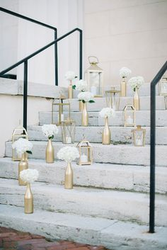 Gold Candle and Floral Display on Reception Venue Steps