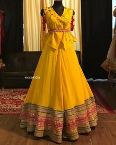 Mustard peplum jacket Lehenga with pink tassels – Ricco India - Rock Indian Gowns Dresses, Indian Fashion Dresses, Dress Indian Style, Indian Designer Outfits, Designer Clothing, Indian Wear, Maxi Dresses, Designer Party Wear Dresses, Kurti Designs Party Wear