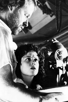 Ridley Scott and Sigourney Weaver during the filming of 'Alien', 1979.