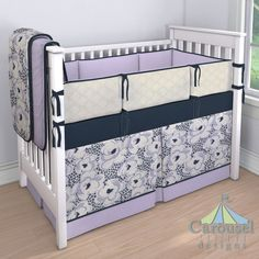 Baby Girl Crib bedding in Solid Navy, Purple and Navy Leopard Floral, Solid Lilac, Textured Lattice, Solid Lilac Minky. Created using the Nursery Designer® by Carousel Designs where you mix and match from hundreds of fabrics to create your own unique baby bedding.