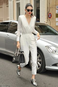 Bridal whites: She topped off the look with relaxed buckle shoes in a metallic shade...