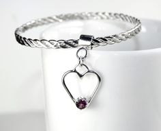 Hallmarked Sterling Silver Twisted Hammered Bangle with Sterling Silver Heart Charm set with Rhodolite Garnet Gemstone by WovenArtJewellery on Etsy