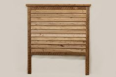"""The Farmhouse Headboard (IC-HB-100) is from our Infinity Collection.  Planks of hardwood are hewn and planed by hand and accentuated saw marks set this piece . The pieces are then mortised together with a louvered fit to create this masterpiece.  Our Infinity Collection also includes nightstands that will work beautifully.  The bed is shown with NO finish but other finishes are available.  64 3/4"""" wide x74"""" height, 20 """" from clearance to floor"""