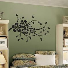 Love the idea of the bookcases on each side of the bed instead of a headboard!