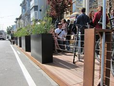 """A """"parklet"""" in San Francisco, built on two former parking spaces that were moved to the site of a former bus stop. Photo: Matthew Roth."""