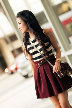 Office Style (Her): Burgundy skirt, stripe top, and leopard belt.