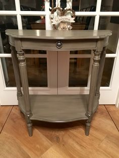Gorgeous vintage console table painted in Annie Sloan French linen with graphite dry brushed all over to give the appearance of stone!