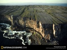 """Rugged as the people who settled here more than 3,000 years ago, the sea-chiseled limestone bluffs of Inishmore rise 300 feet above the Atlantic. Inland, hundreds of miles of stone walls ring thin-soiled fields where islanders toil in a land known for ciúnas gan uaigneas, Gaelic for 'quietness without loneliness.'""    — Text from ""The Aran Islands: Ancient Hearts Modern Minds,"" April 1996, National Geographic magazine"