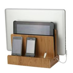 With room for a laptop, tablet and up to 3 devices this sturdy stand holds and hides unsightly cords. A magnetic base flips open to reveal a hidden storage compartment for wires that otherwise clutter up your desk space.