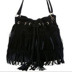 Nwot Drawstring Tassel Bag Has adjustable shoulder strap. Is new, but has no tags. Bags Crossbody Bags