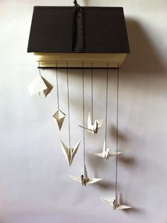 altered books ; I like how it hangs on the wall with things hanging out.