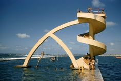 natgeofound: Children swim and play in oceanside pool, February by Franc & Jean Shor, National Geographic Casablanca, National Geographic Archives, Usa Tumblr, Water Slides, Cool Pools, Rare Photos, Playground, Around The Worlds, Ocean