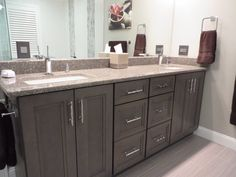 Master Bath double vanity with grey smokey hills finish.  Countertop is cambria Minera with rectangular sinks.  Faucets are hansgrohe Pura Vida