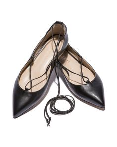 A black, pointed flat is timeless and sleek. Here, a singular lace weaving along the topline and wrapping around the ankle dials up the drama.