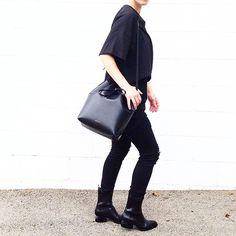 All black. Mansur Gavriel Bucket Bag. Alexander Wang Anouck Boots. Street Style - OVRSLO