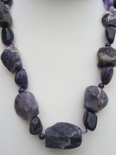 Hey, I found this really awesome Etsy listing at https://www.etsy.com/listing/113215152/purple-amethyst-gemstone-necklace-ooak
