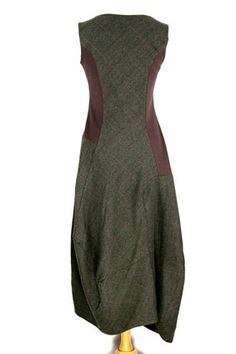 Rundholz - I like the fitted shape of this dress, high neck, interesting bottom but not too full.