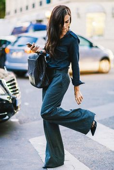 Denim jumpsuit + pointy toed heels + black purse