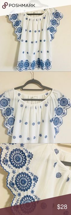 Gap White and Blue Embroidered Top Medium NWT Hi! This is a blue and white embroidered GAP top, womens size medium, swoopneck, brand new and with tags! Perfect for spring & summer! Length: 25 inches Across chest: 22 inches Thanks for looking, any questions just ask!  *Bundle 2 or more items for 15% off my closet!* GAP Tops Tunics