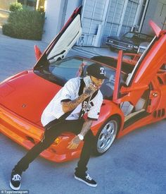Red hot! Kylie's rapper boyfriend Tyga also flaunted an Instagram photo on Saturday as the Rack City hitmaker showed off his bright red Lamborghini