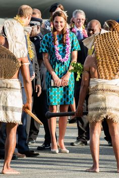She arrived at Henderson Airport on the Solomon Islands wearing a patterned Jonathan Saunders dress, Jane Taylor hat and LK Bennett heels.