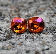 Vintage Swarovski Crystal Earrings - Super Sparklers -  Orange Pink Diamond Square Princess Cut Studs. $19.50, via Etsy.
