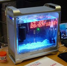 This bespoke fishtank is built into an Apple Mac G5 case  It includes an Arduino mega, and a servo, an LED matrix display, an LCD display, Internet connectivity (with mobile web interface) and timed LED lighting  Controllable from any internet enabled device, but doesn't feed the fish (yet)!