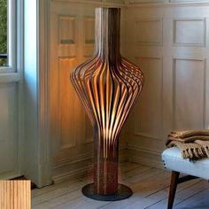 The floor lamp Diva is more than just a simple light. The approach of the designers to its design was playful and artistic at the same time, so as to create a real piece of art. It is largely made of wooden slats. They are laminated by 1.5 mm thick walnut or oak wood. All of these make it a perfect material to build an artistically bent cage, which conceals a satin-finished and mouth-blown glass ball.