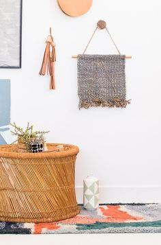 Looking for a simple art project to try? Check out this wall art DIY - it's an embroidered wall art idea that looks great and is easy to make. #diy #wallart #fiberart #homedecor #boho