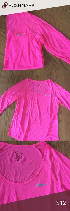 Nike DRI-FIT top Really cute Nike top!  Bright pink, like a fluorescent pink.  Great shape except for a tiny snag at the back side neck area.  See photo. 3/4 sleeves. Nike Tops
