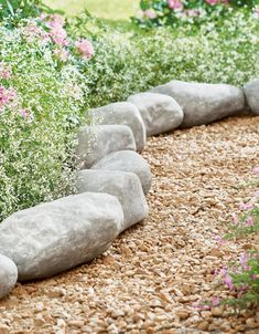 Like Mother Nature crafted it herself, our Faux Roche Lawn Edging is hand-cast from crushed stone and dry-stamped to simulate natural limestone. You'll get 14 stones in the set, each with a stake for securing individually into the ground. Use them, end-to-end, to line your flowerbed, or in decorative groupings. Rock Edging, Lawn Edging, Garden Owl, Garden Oasis, Faux Rock, Tall Planters, Flower Circle, Crushed Stone, Grandin Road