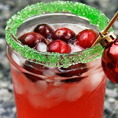 Cranberry Margaritas~4 servings  Wedge of lime  Sugar  Ice for shaking and serving  1/2 cup cranberry juice   1/2 cup silver tequila  1/4 cup orange liqueur (Grand Marnier, Triple Sec)  1/4 cup fresh lime juice  Garnishes: thinly sliced limes or fresh cranberries  Run a lime wedge around the rim of the glass, and dip the edge in sugar to coat. Fill glasses with ice. In a cocktail shaker filled with ice, combine all the ingredients, and shake. Strain into ice-filled glasses and serve.