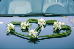 Heart shaped decoration with flowers for the wedding car
