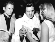 """Gaylene Moos/ Elvis at the Spokane, WA,train station on Aug 29, 1957. """"I finally mustered up the ability to ask for his autograph, at which time he smiled at me, leaned over and kissed me on the cheek, took hold of my hand and nicely said, """"I already signed your book, Dahlin'.""""  I embarrassingly looked down at my book, and sure enough, there was his autograph. He had actually taken the book out of my hand, signed it, and slipped it back into my hand without my realizing it…"""