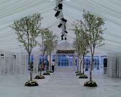 Hate the tent; love the tree idea.. maybe two of these flowering trees flanking the fireplace in the reception hall.