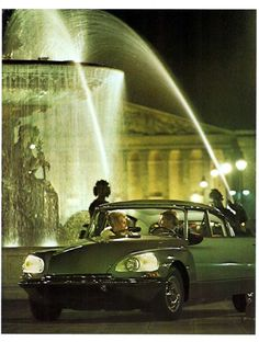 """Night on the town with The Citroen DS (""""Deesse"""".  """"The Goddess"""")..  When introduced in 1955, it was an absolute sensation. It had futuristic styling and was a technological marvel for the masses. Today it remains an icon in automotive achievement."""